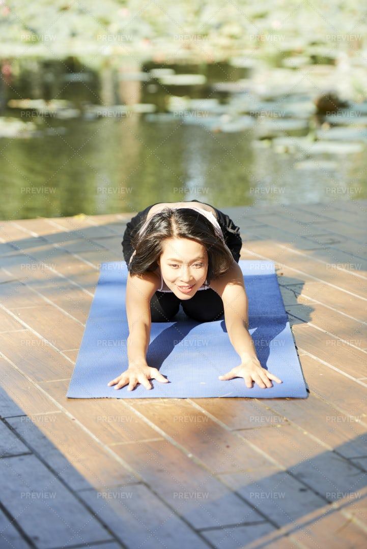 Young Woman Stretching Forward: Stock Photos