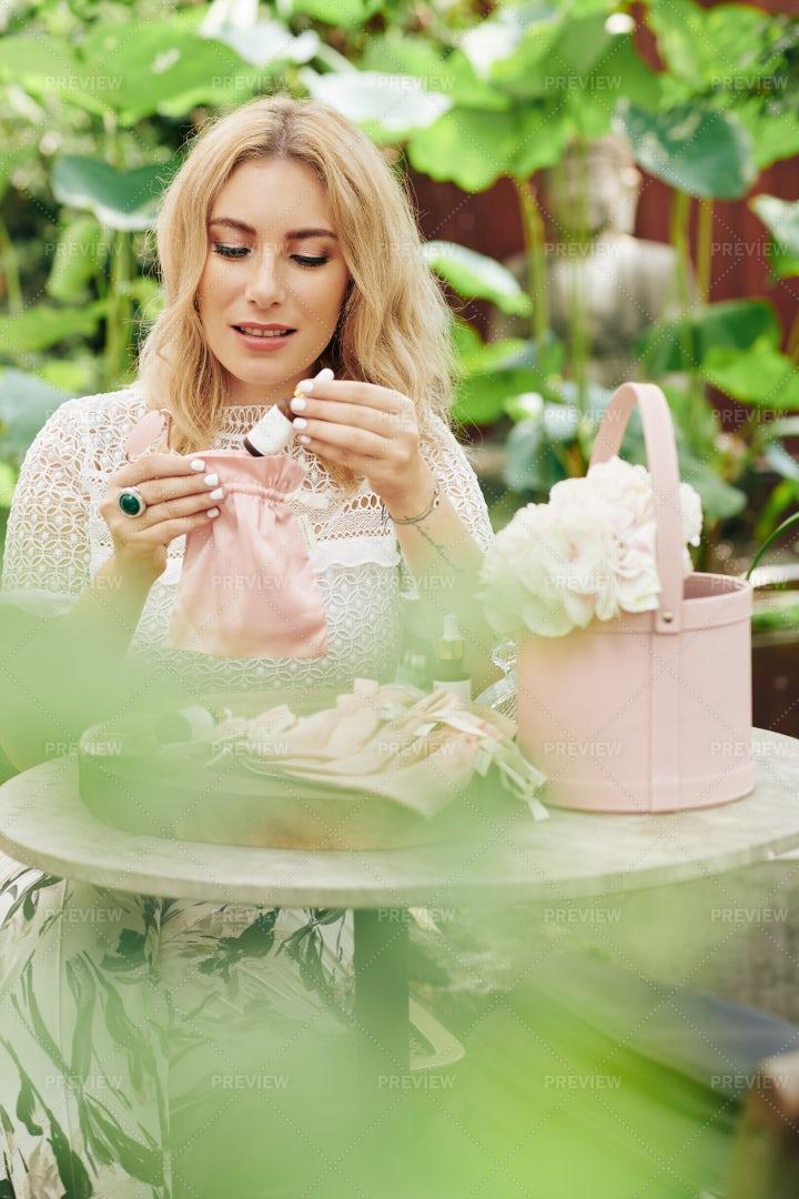 Woman Packing Organic Cosmetics: Stock Photos