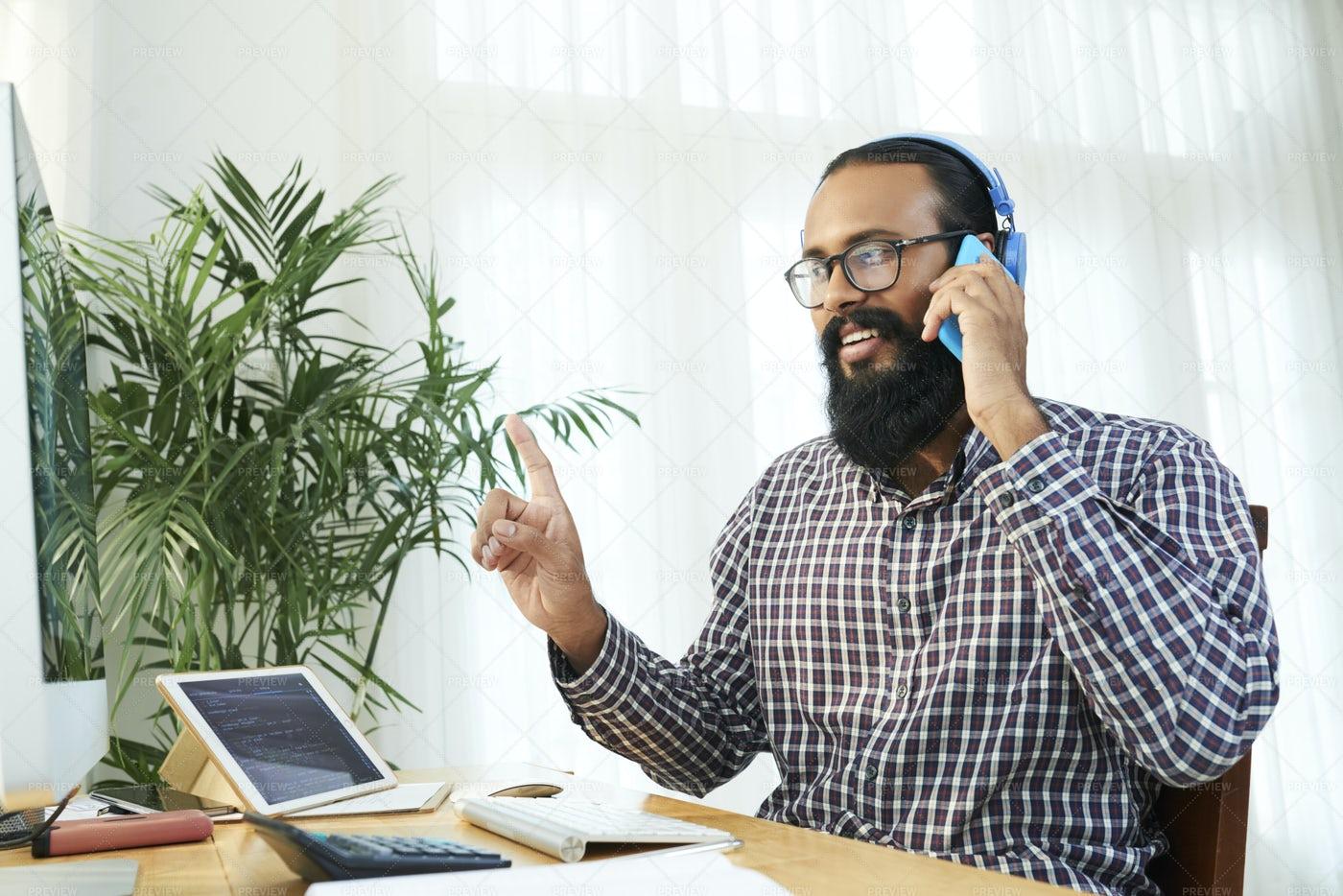 Businessman Has A Phone Call At Office: Stock Photos