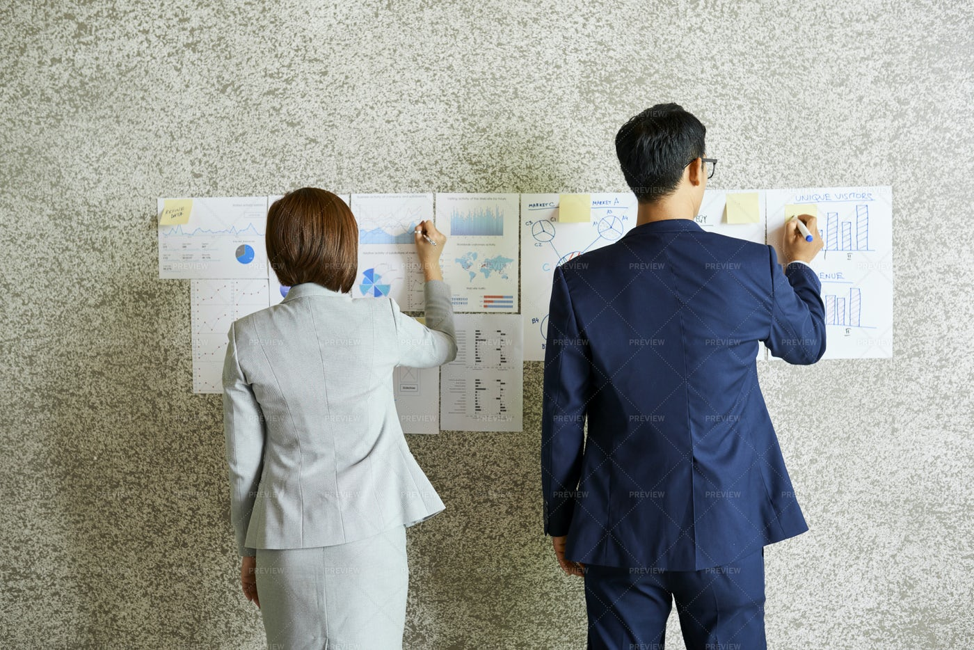 Business People Analyzing Charts: Stock Photos