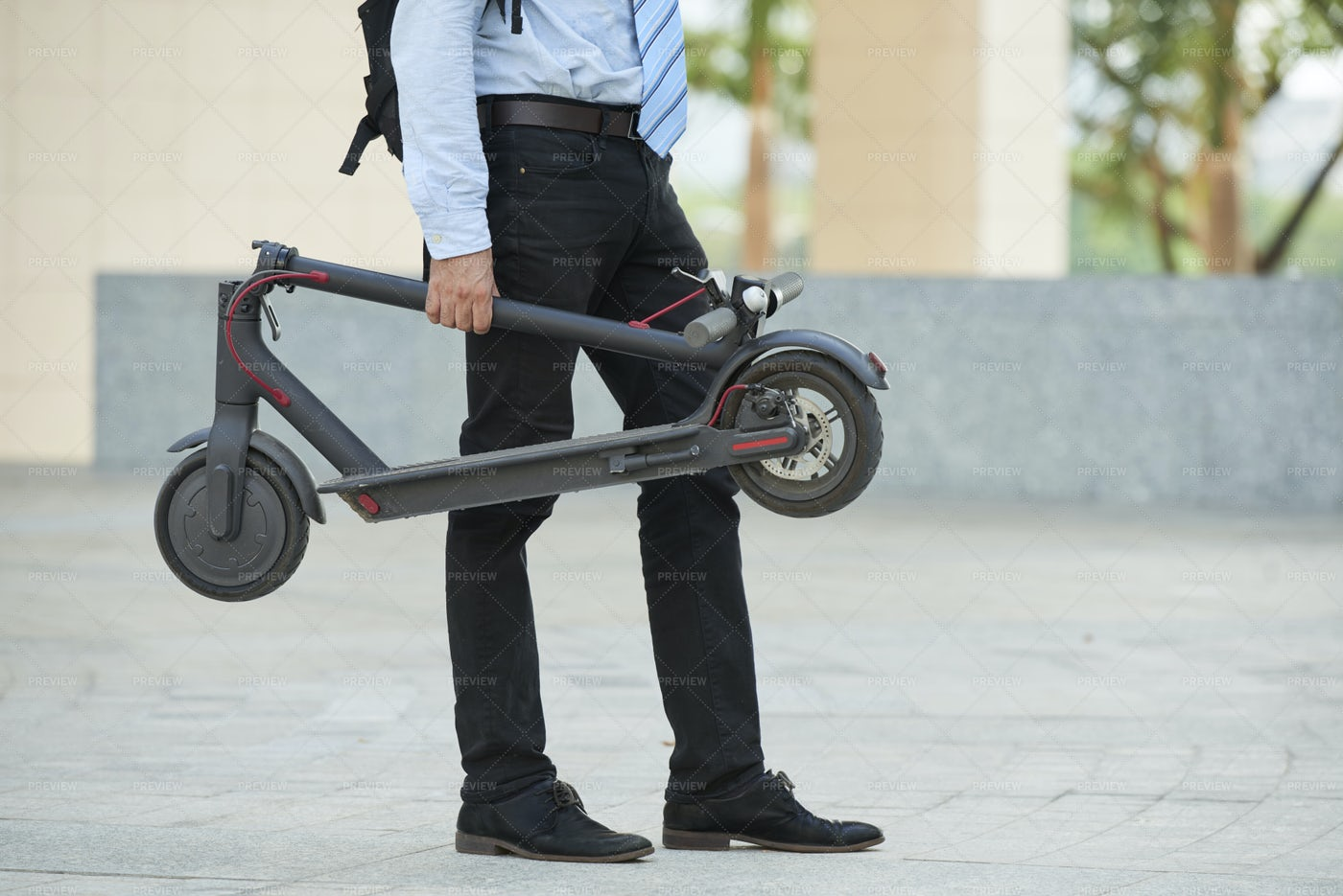 Man With Scooter Standing Outdoors: Stock Photos