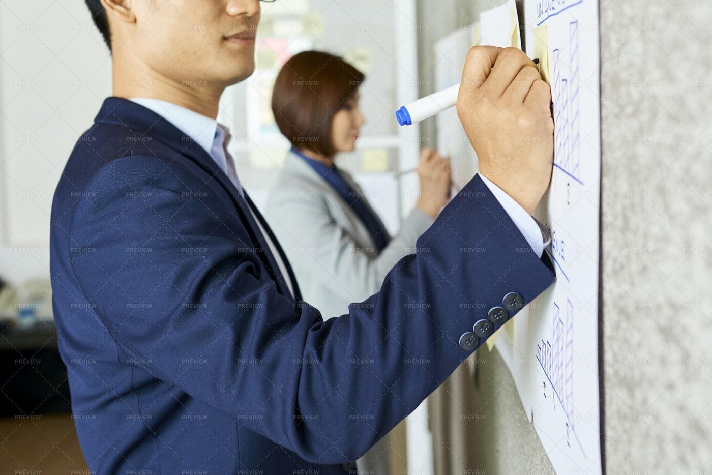 Businessman Drawing Diagram: Stock Photos