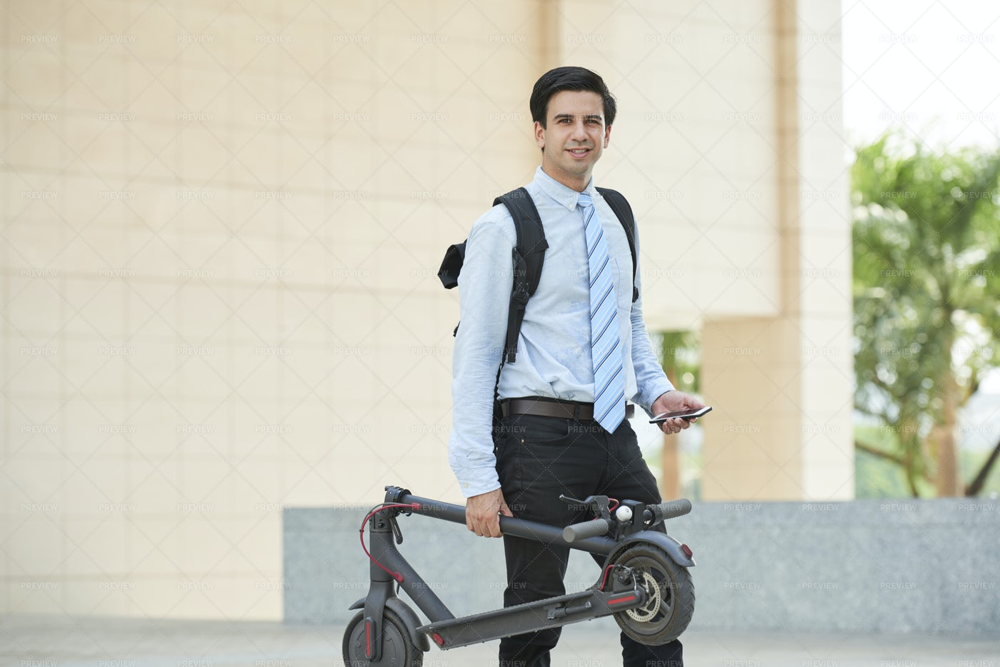 Man Is Going To Work On Scooter: Stock Photos
