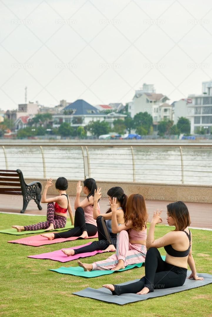 Women Doing Yoga Outdoors: Stock Photos