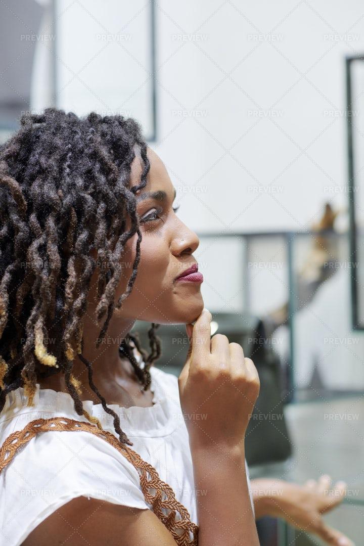 Pensive Woman In Fashion Boutique: Stock Photos