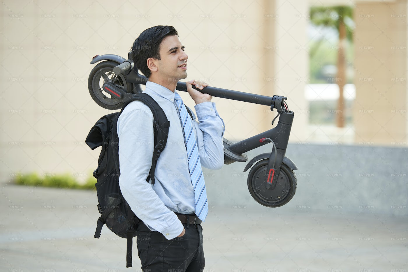 Businessman With Scooter In The City: Stock Photos