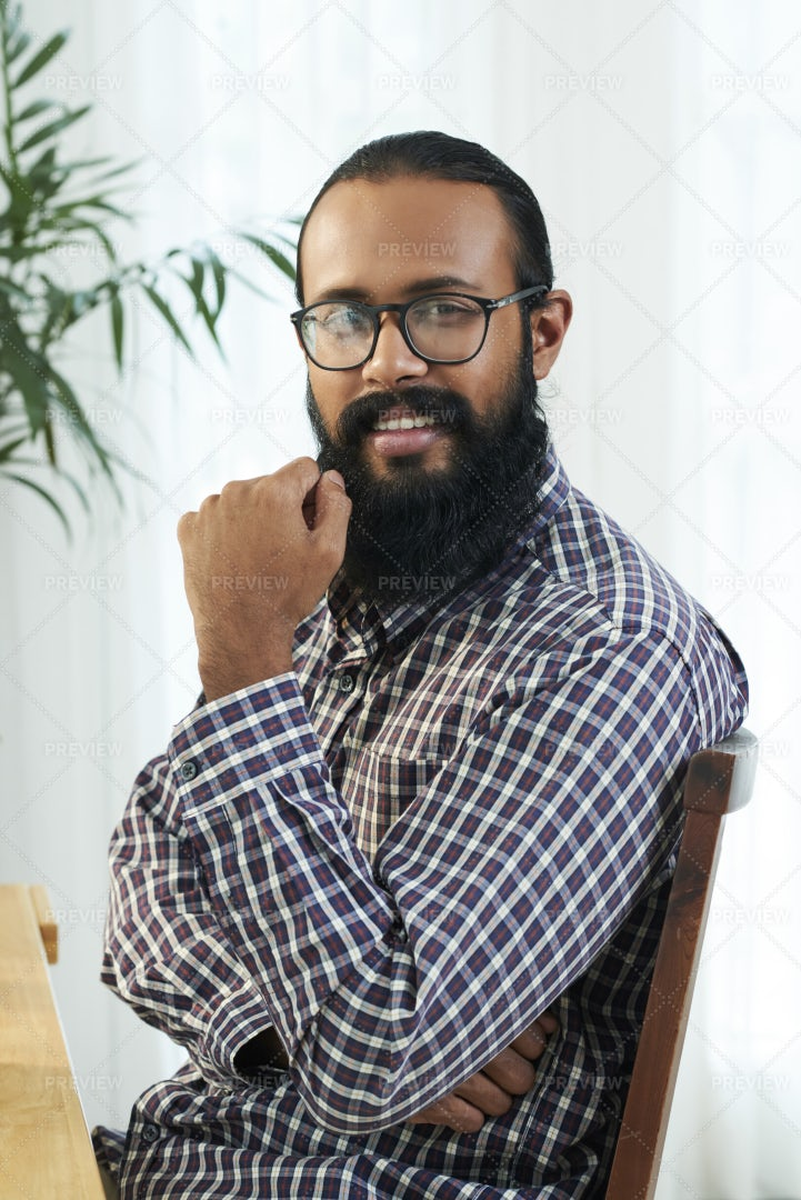African Bearded Man Sitting At The: Stock Photos