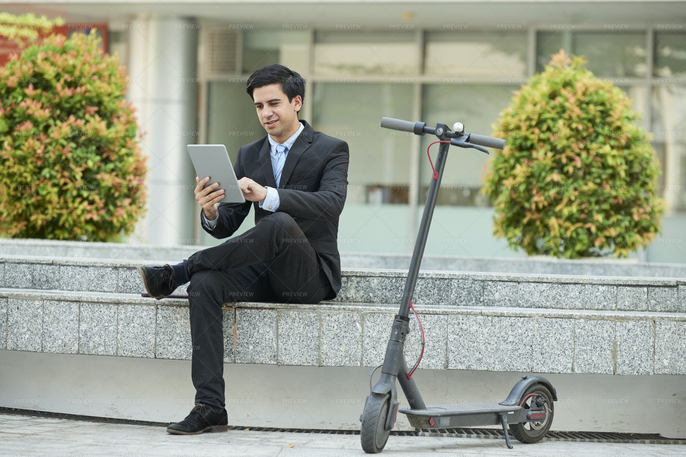 Businessman Using Tablet Pc In The City: Stock Photos