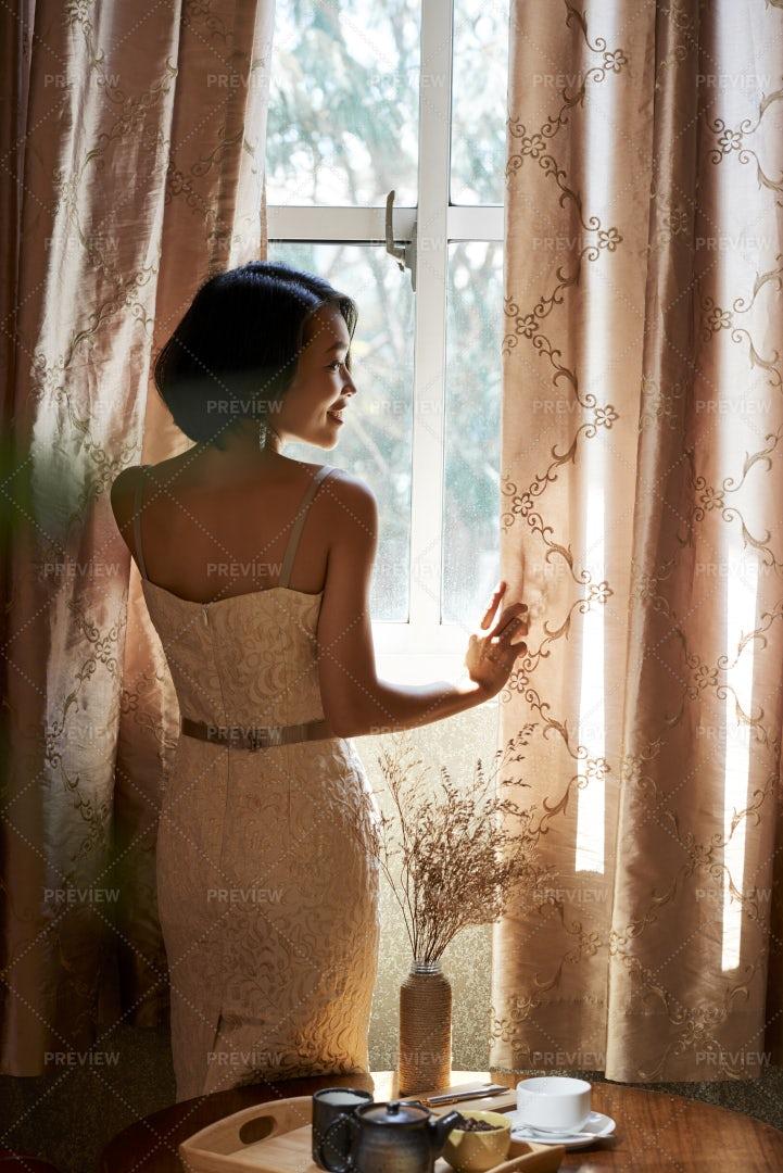 Beautiful Woman Opening Curtains: Stock Photos