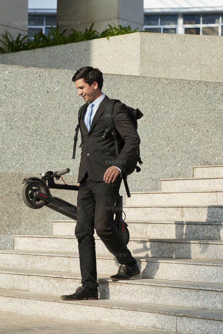 Businessman With Scooter Walking In The: Stock Photos