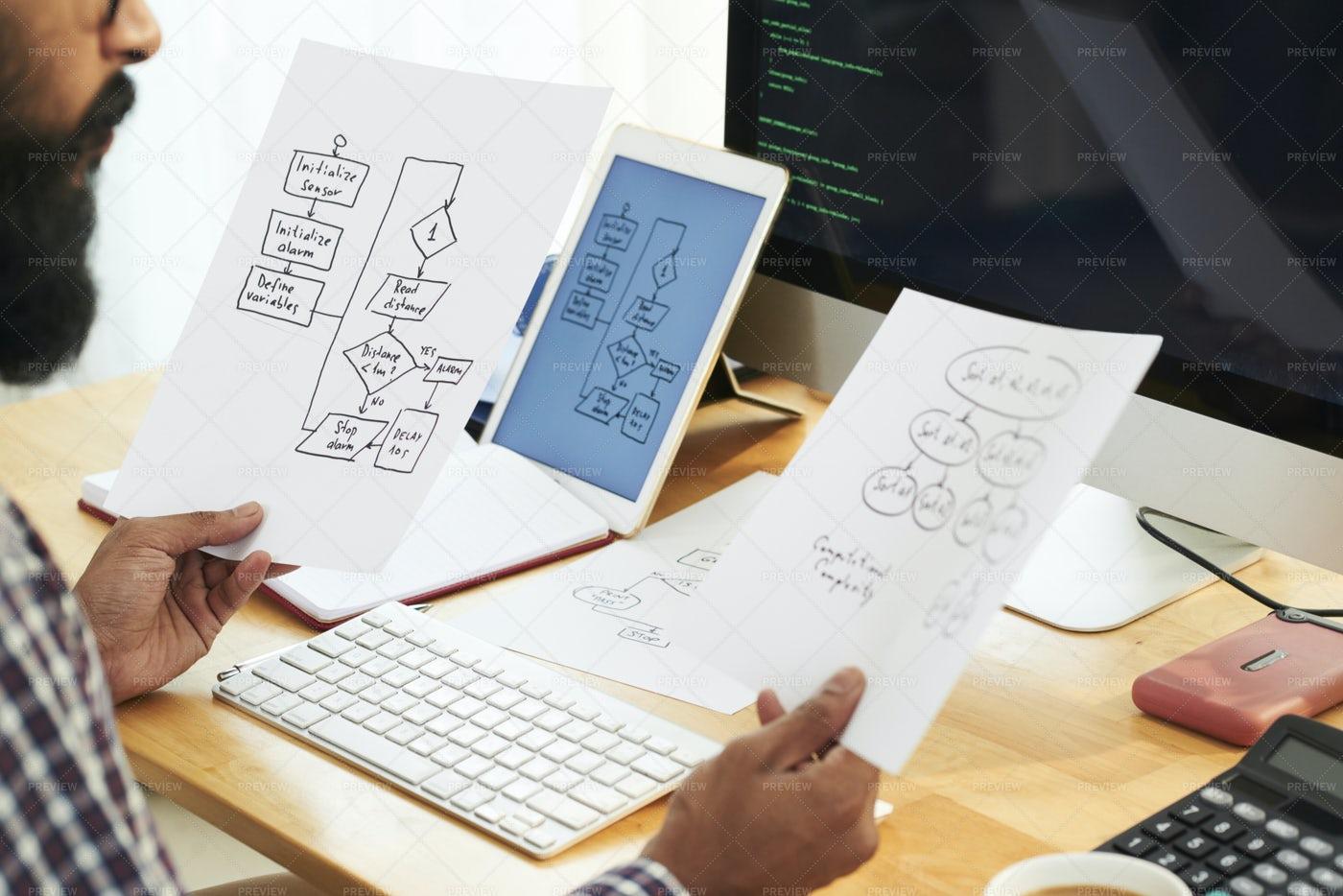 Businessman Examining New Business: Stock Photos