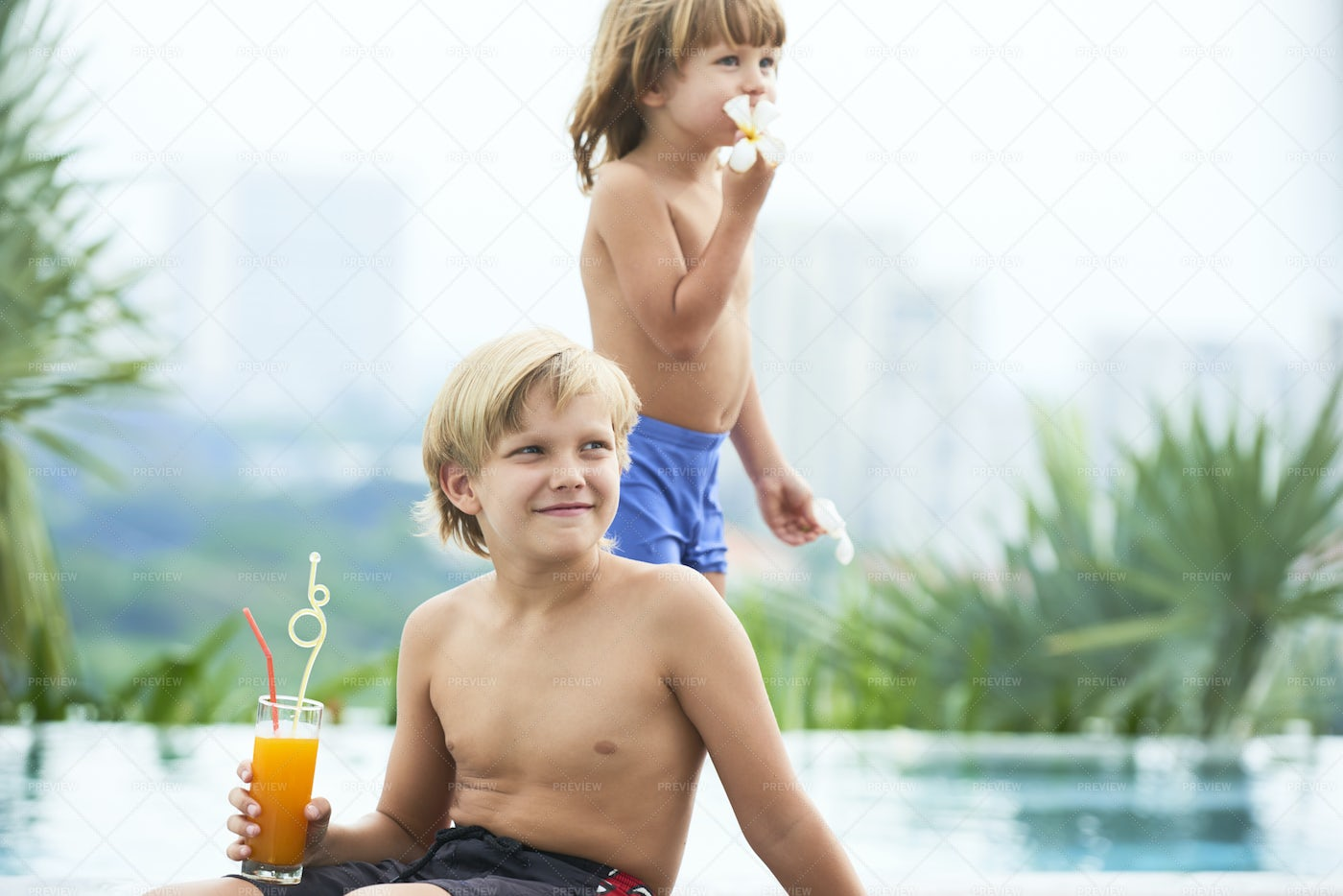 Children Resting By Pool: Stock Photos