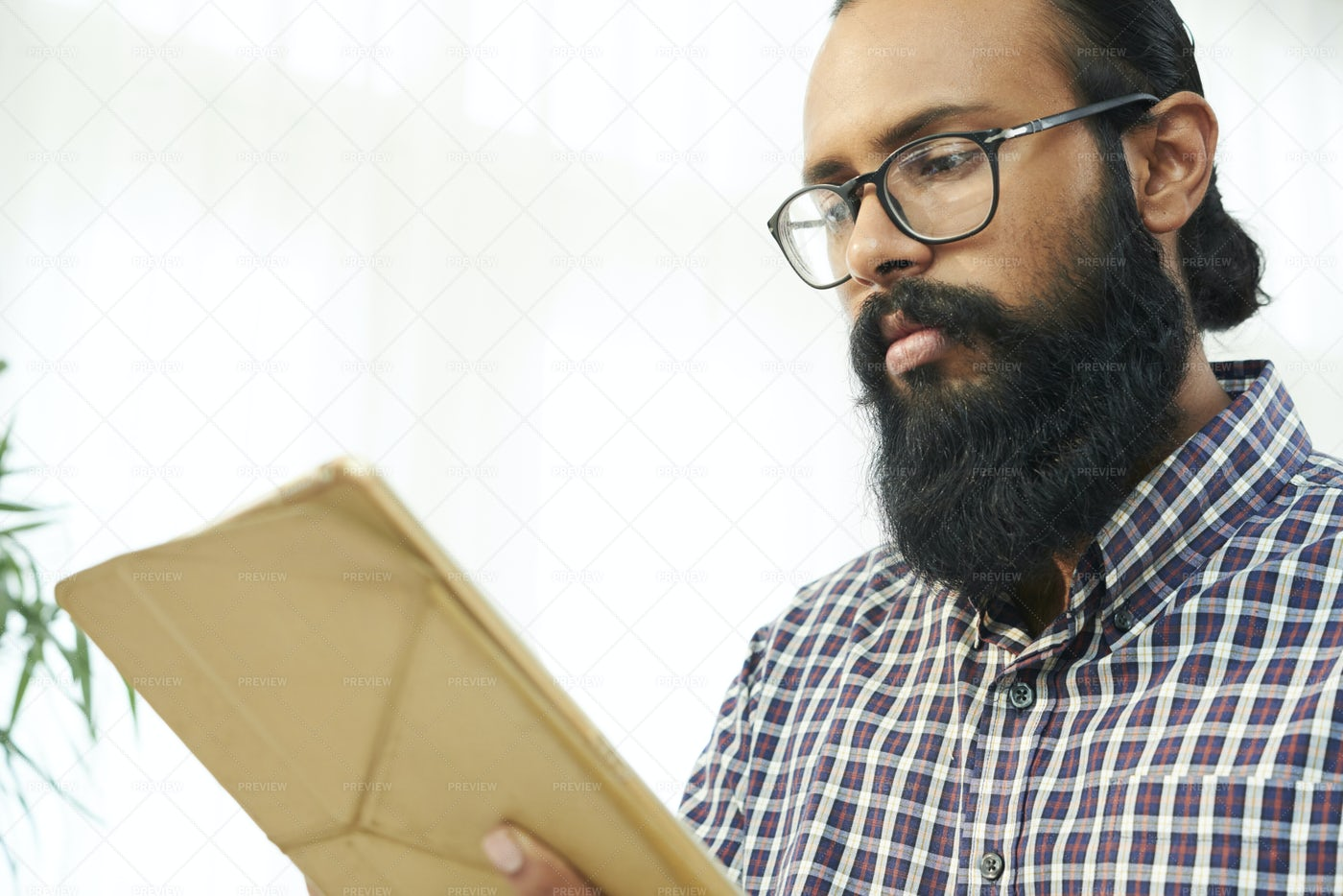 Bearded Man Working Online On Digital: Stock Photos