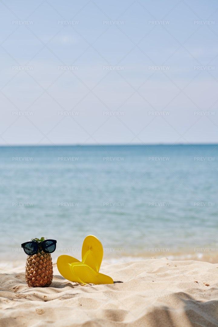 Flip-flops And Pineapple On Beach: Stock Photos