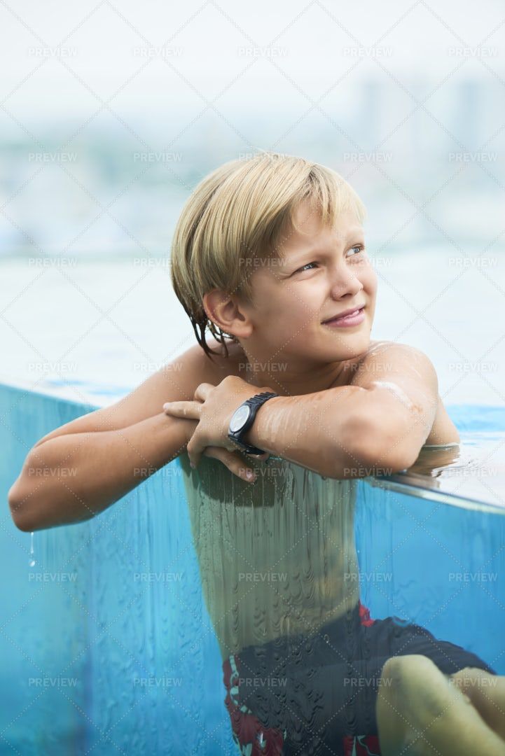Cheerful Boy Resting In Water: Stock Photos