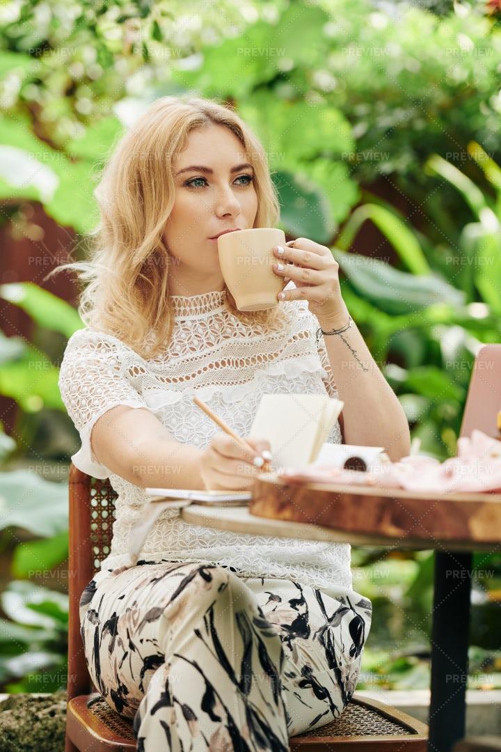 Pensive Woman Drinking Coffee: Stock Photos