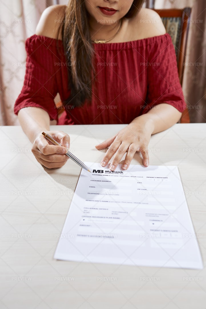 Businesswoman With Contract Sitting At: Stock Photos