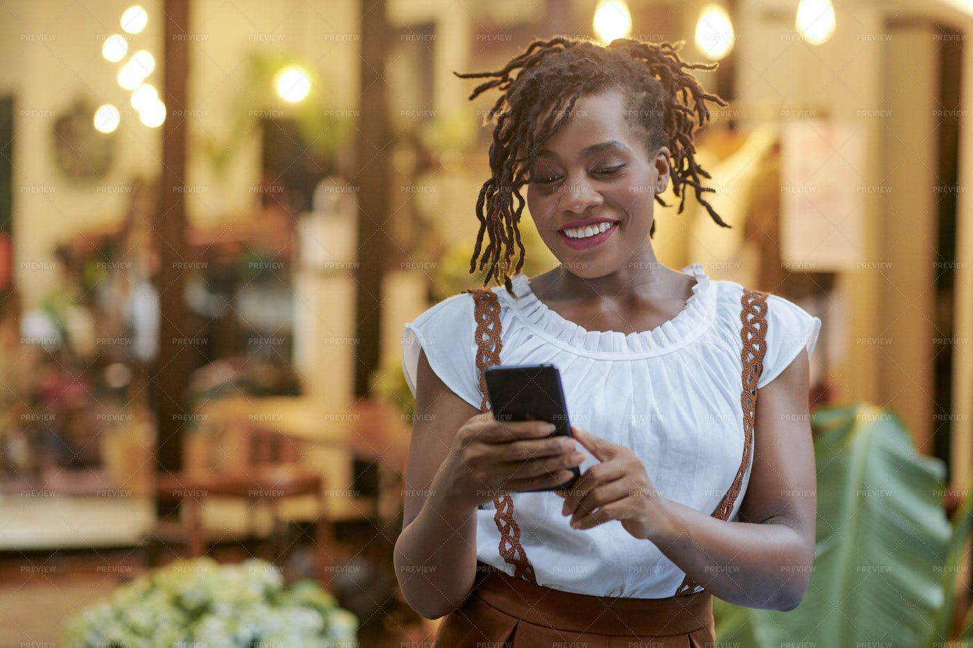 Pretty Texting Young Woman: Stock Photos