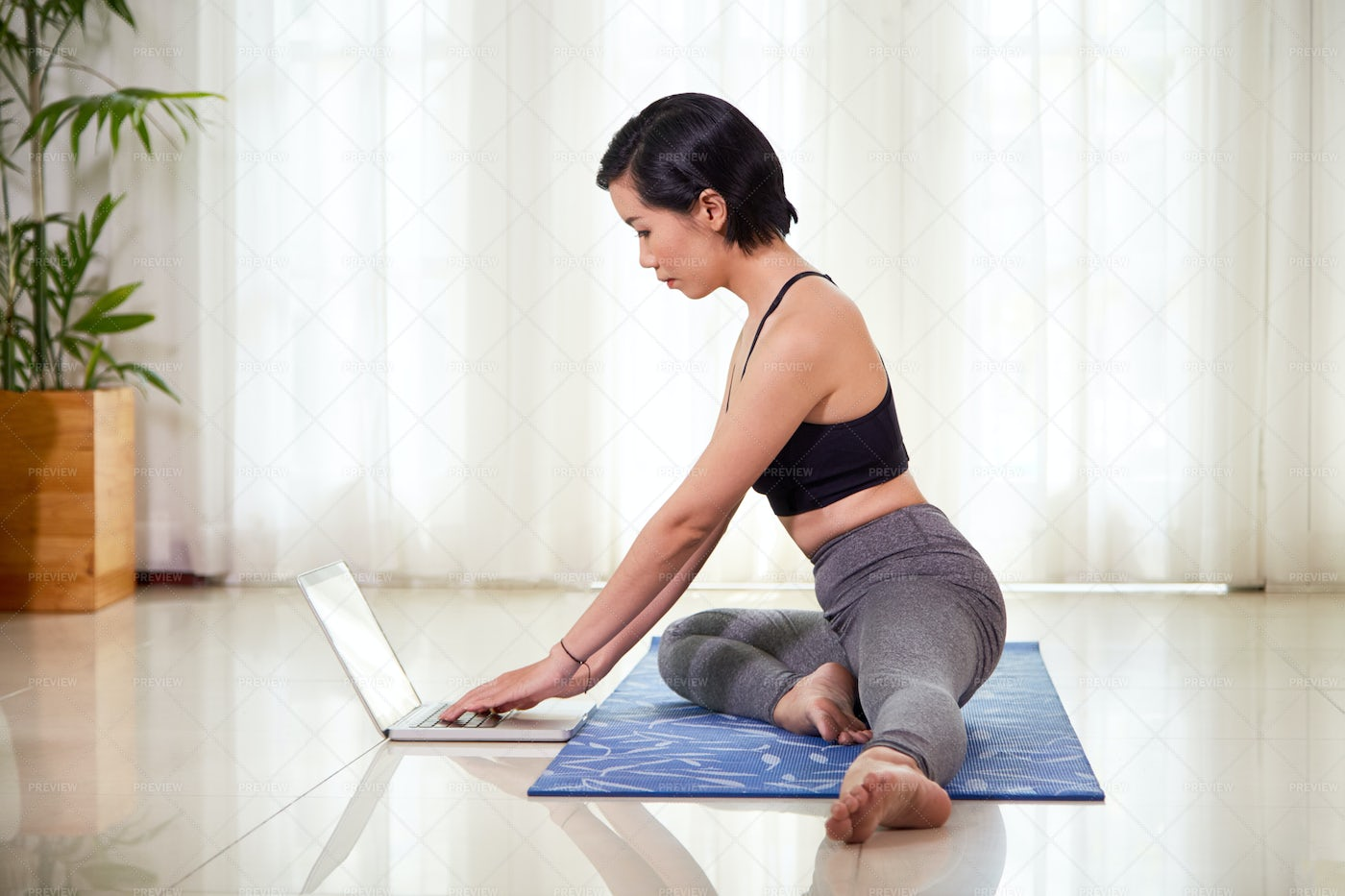 Woman Training With Online Lessons: Stock Photos