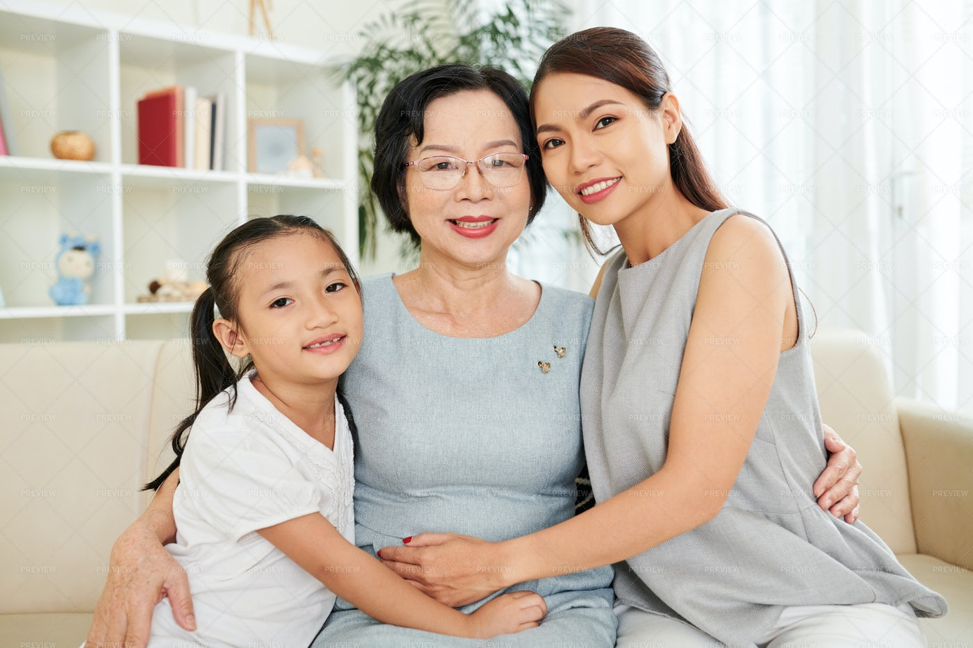 Happy Asian Family At Home: Stock Photos