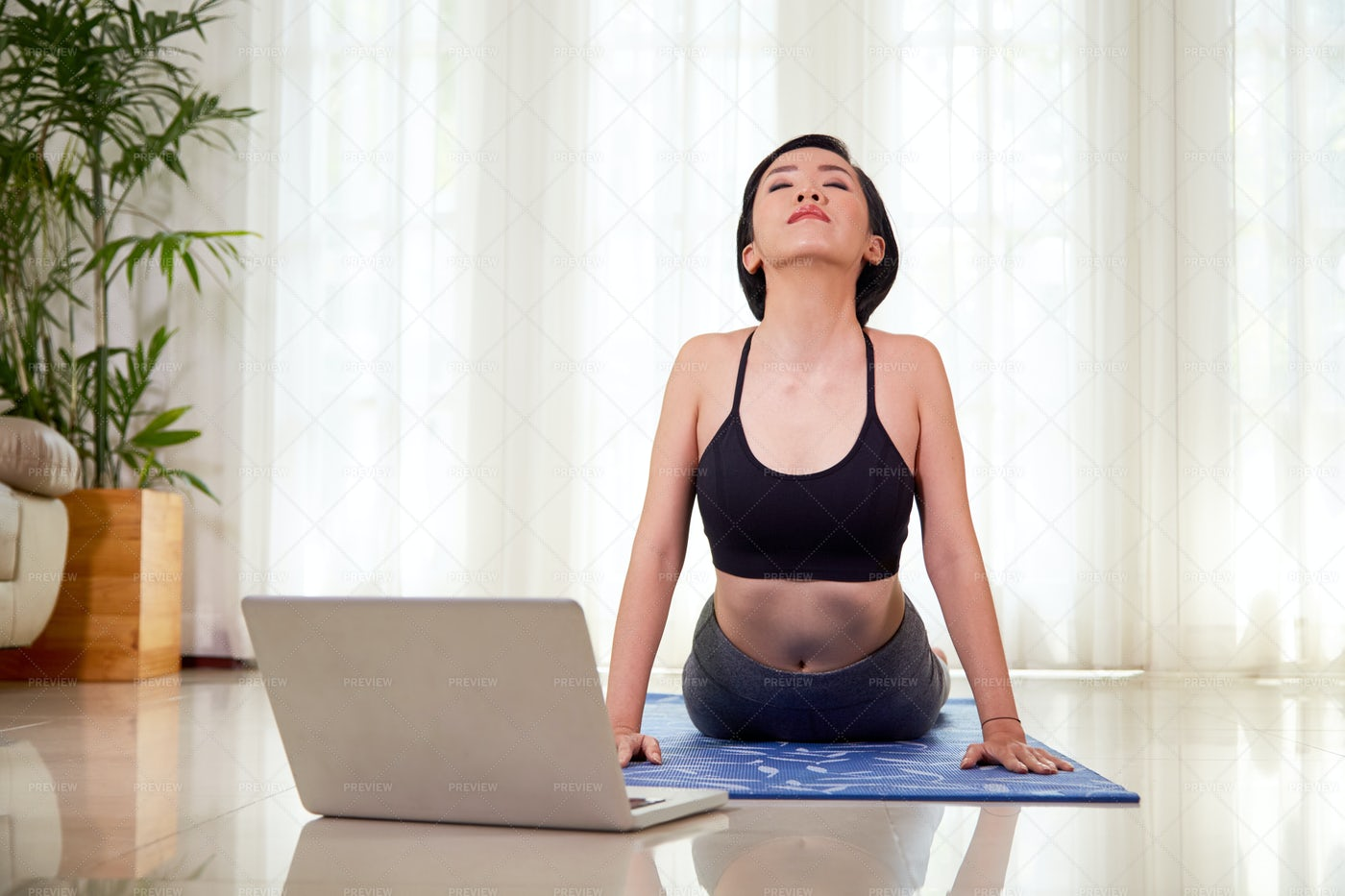 Woman Doing Stretching During Yoga: Stock Photos