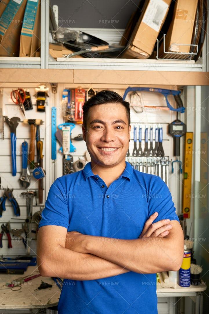 Asian Man Working In Workshop: Stock Photos