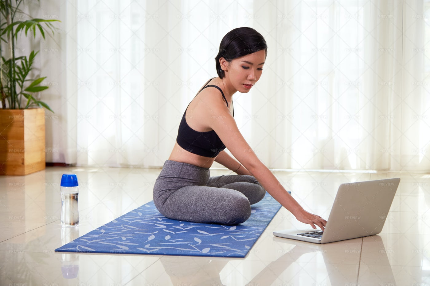 Woman Using Laptop During Training: Stock Photos