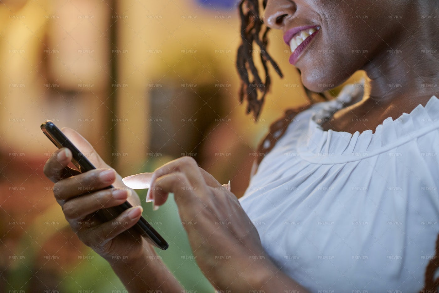 Smiling Woman Texting Friends: Stock Photos