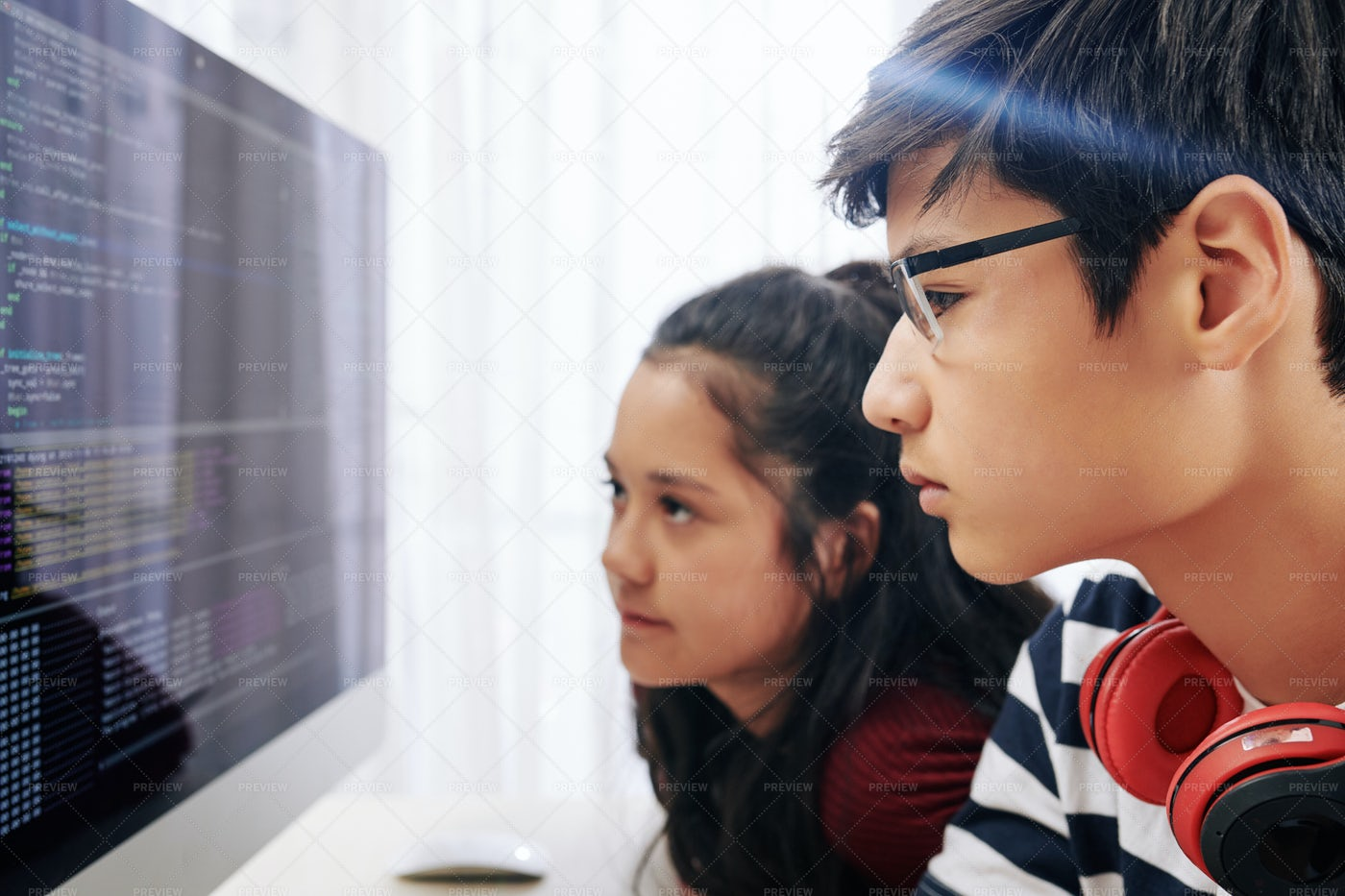 Teenagers Examining Programming Code: Stock Photos