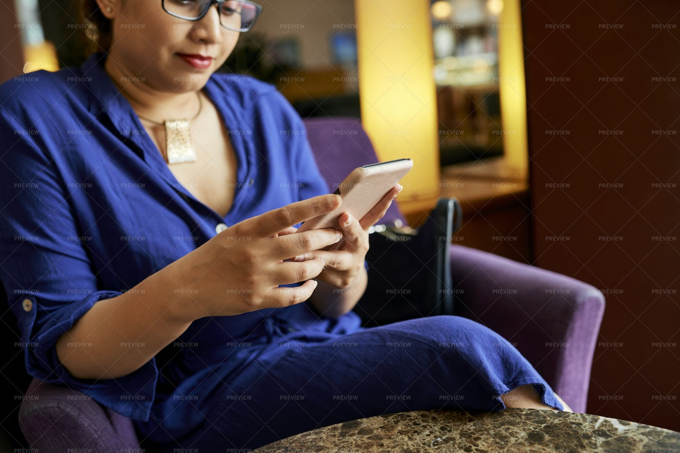 Woman Using Mobile Phone In Cafe: Stock Photos