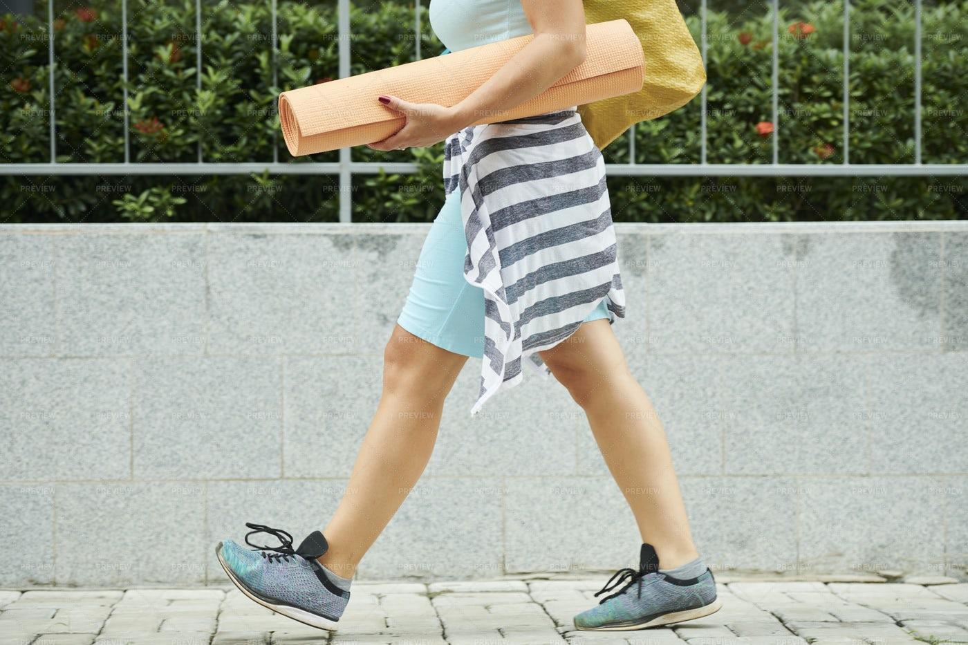 Woman Walking With Yoga Mat: Stock Photos