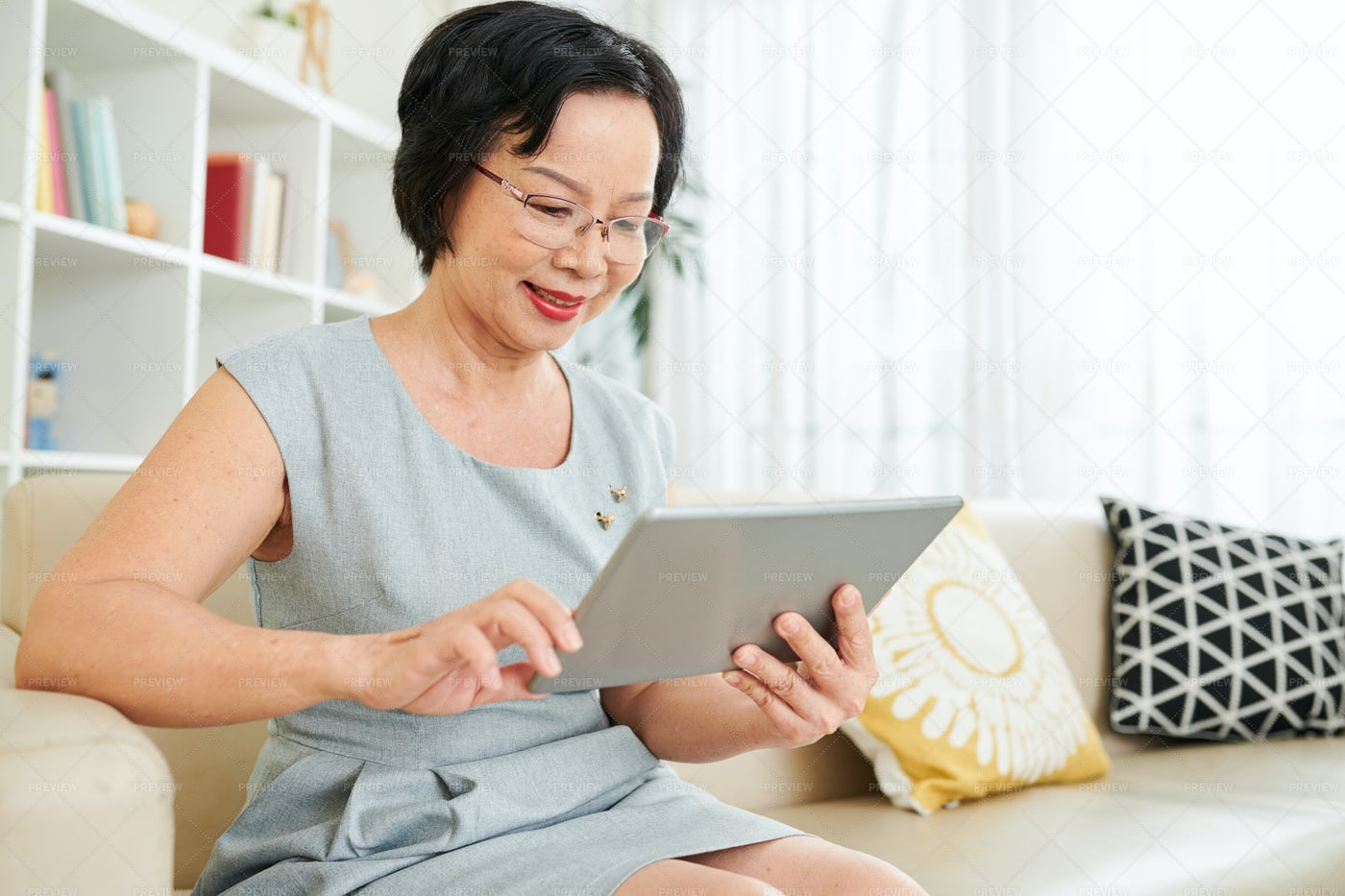 Woman Using Tablet Pc At Home: Stock Photos