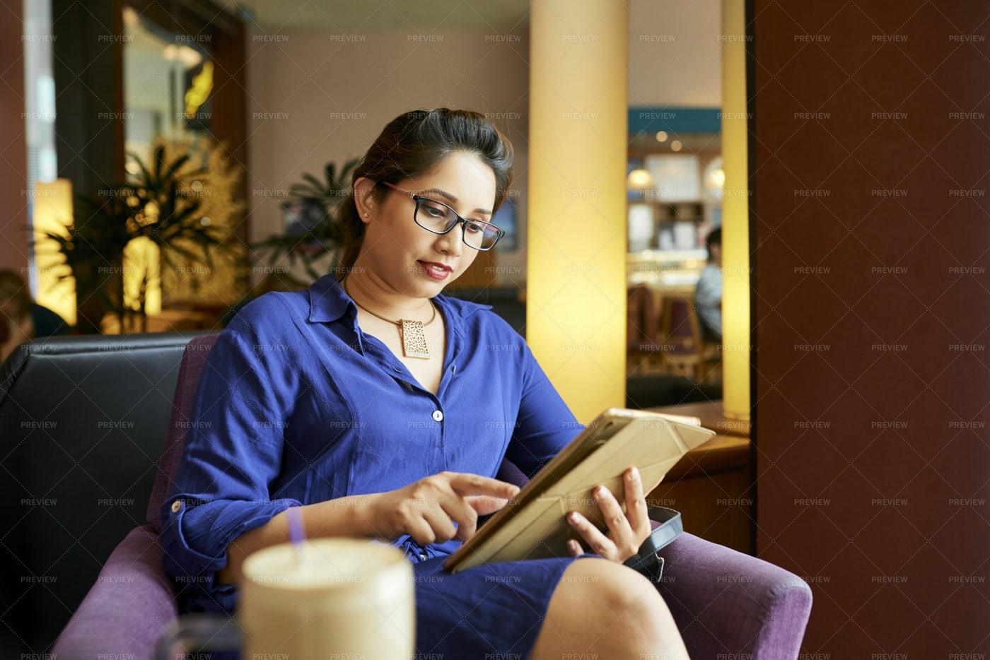Young Woman Using Digital Tablet At: Stock Photos