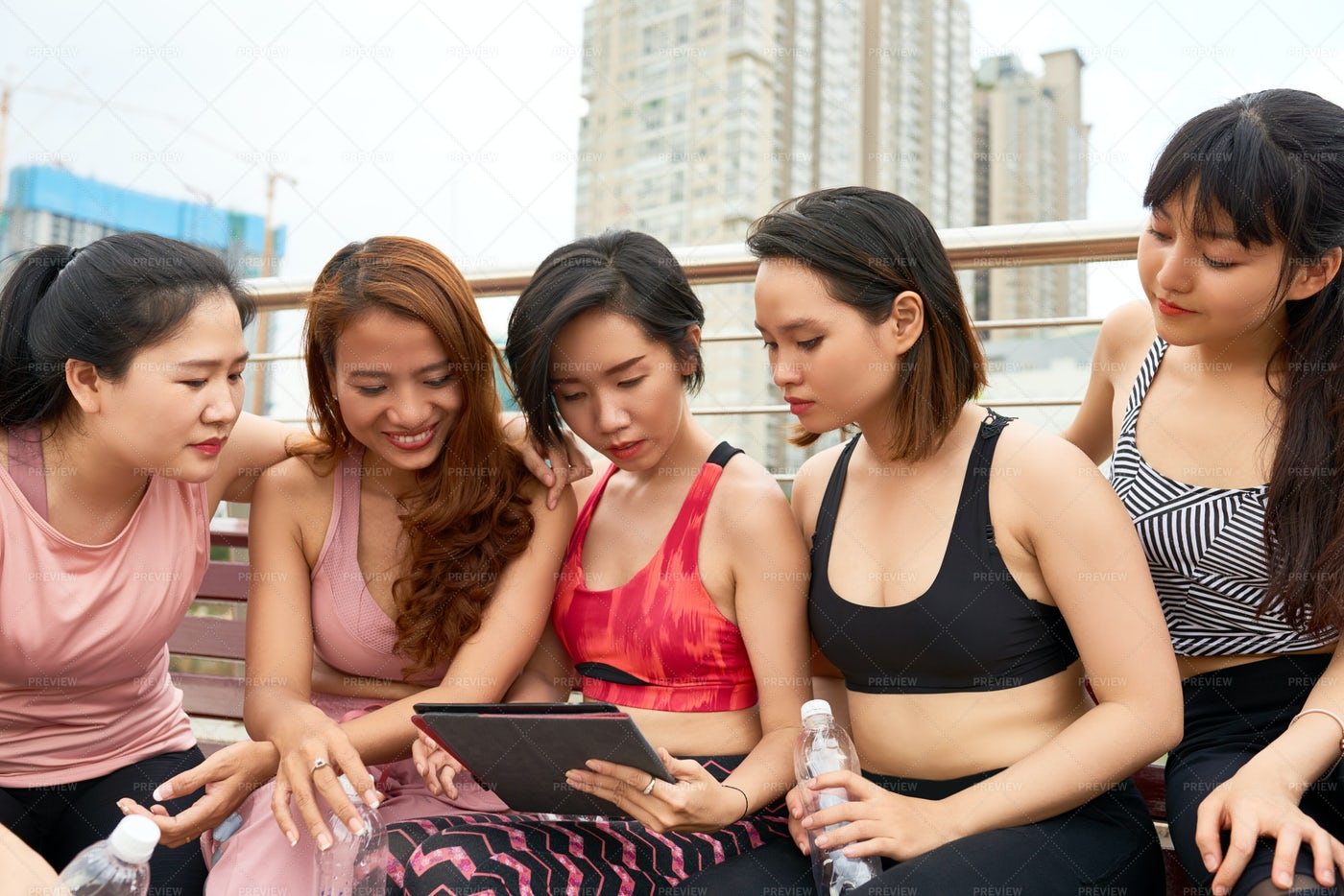 Sport Team Using Tablet Pc Together: Stock Photos