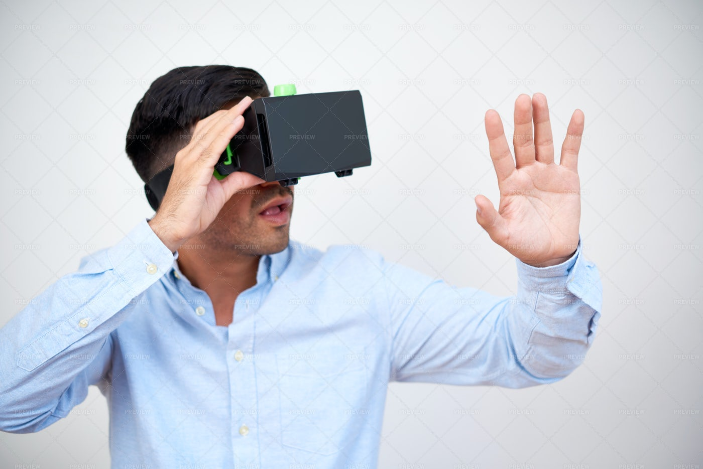 Entrepreneur In VR Headset Watching: Stock Photos