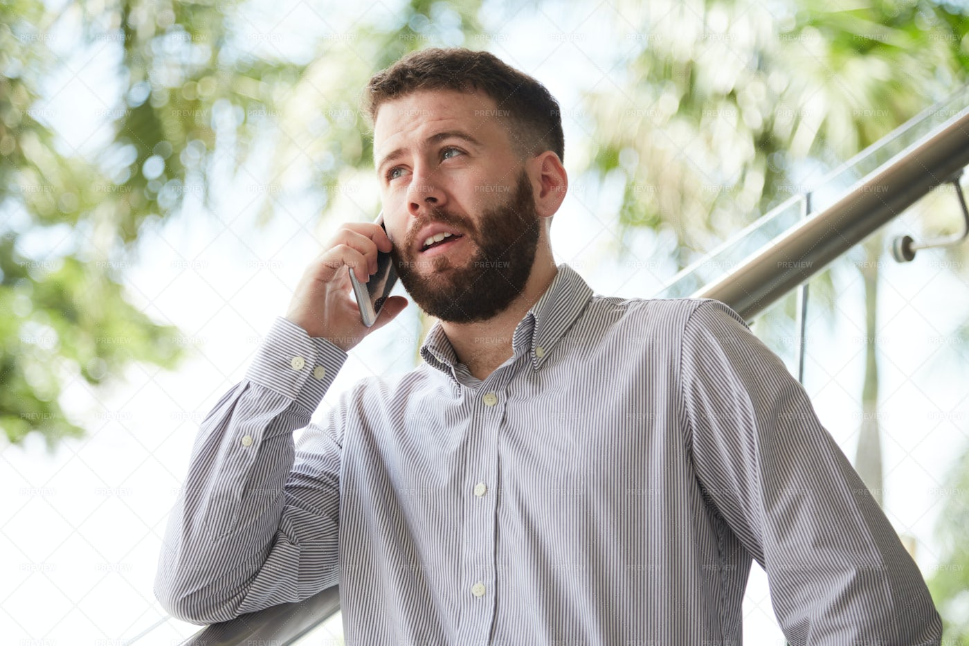 Businessman Using Mobile Phone For: Stock Photos