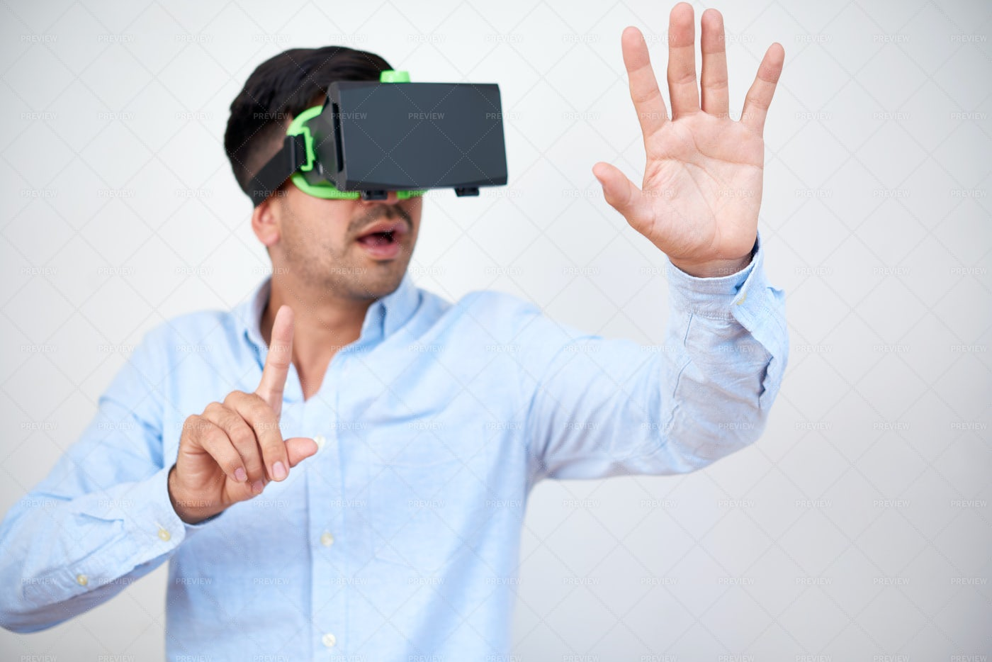 Excited Businessman In VR Headset: Stock Photos