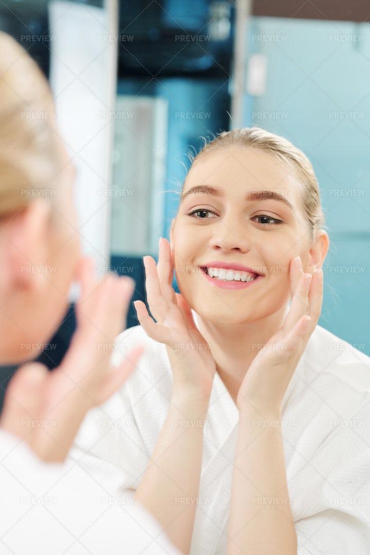 Happy Woman Applying Face Cream: Stock Photos