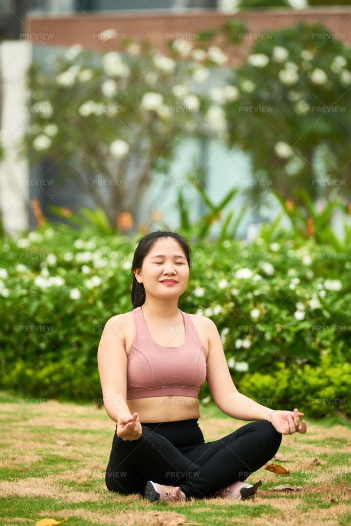 Woman Relaxing In Lotus Position: Stock Photos