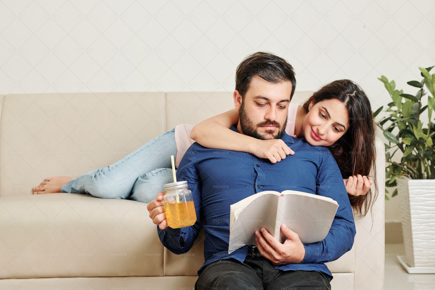 Woman Reading With Boyfriend: Stock Photos