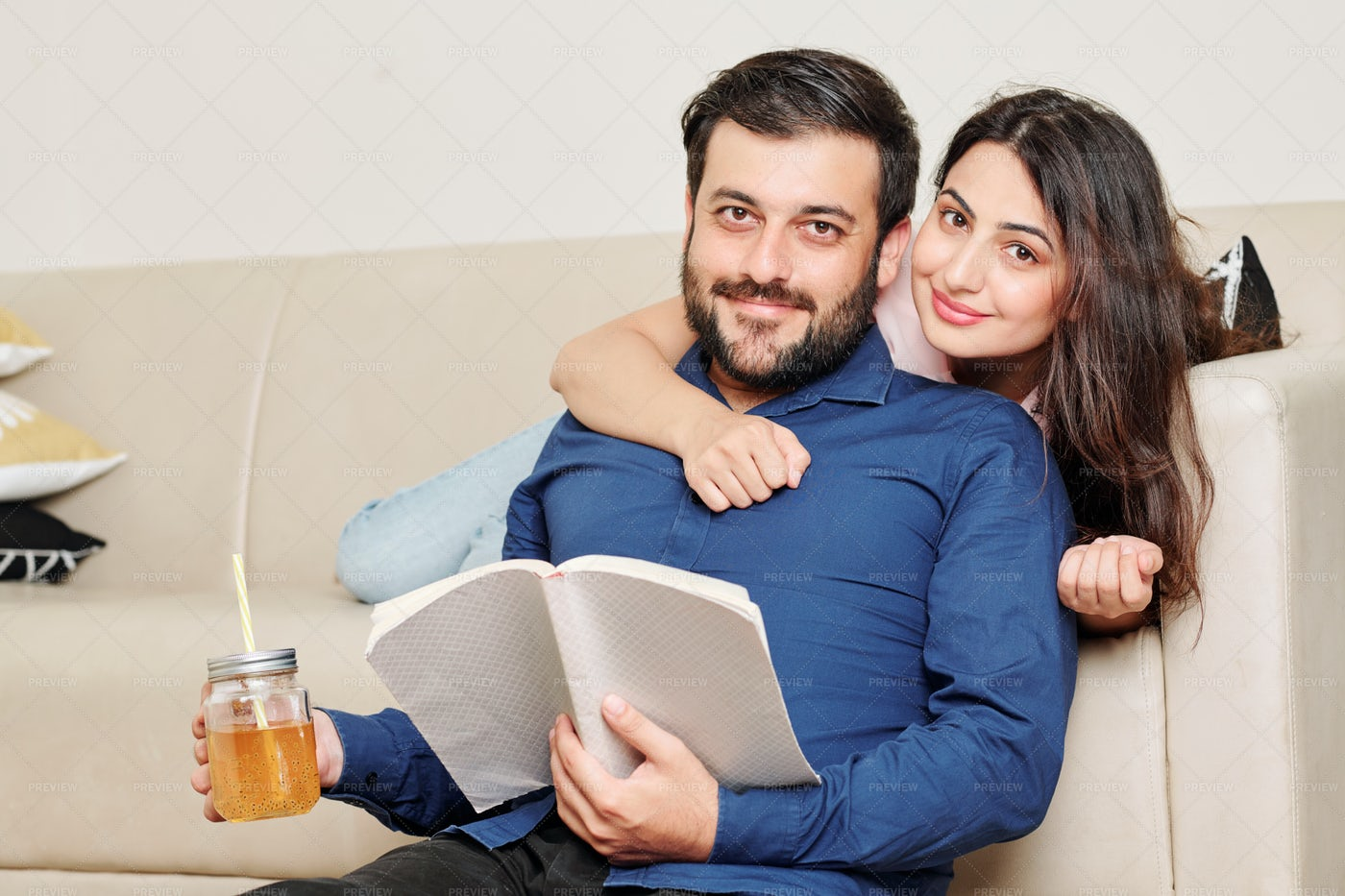Happy Couple Resting A Home: Stock Photos