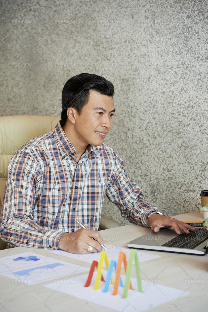 Businessman Comparing Reports: Stock Photos