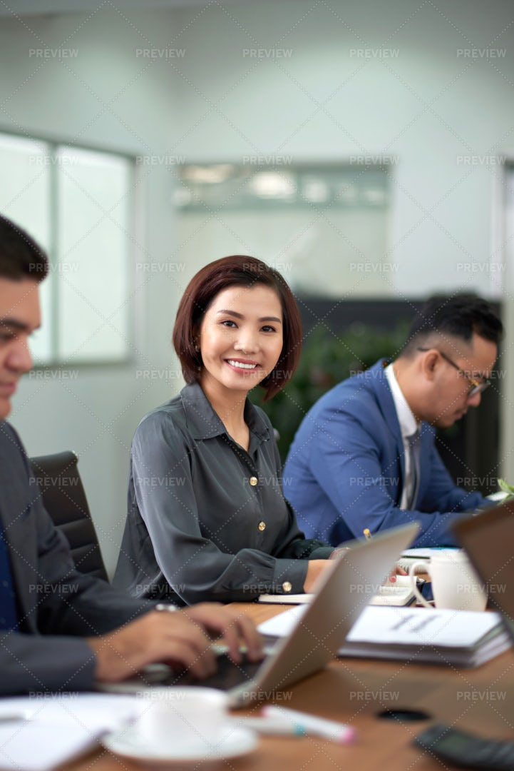 Businesswoman Sitting At Business: Stock Photos