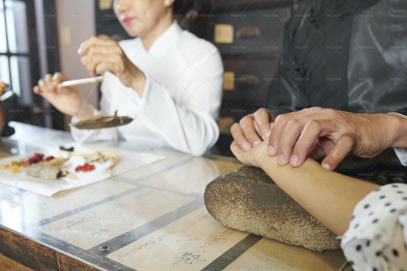 Chinese Medicine Practitioner Taking: Stock Photos