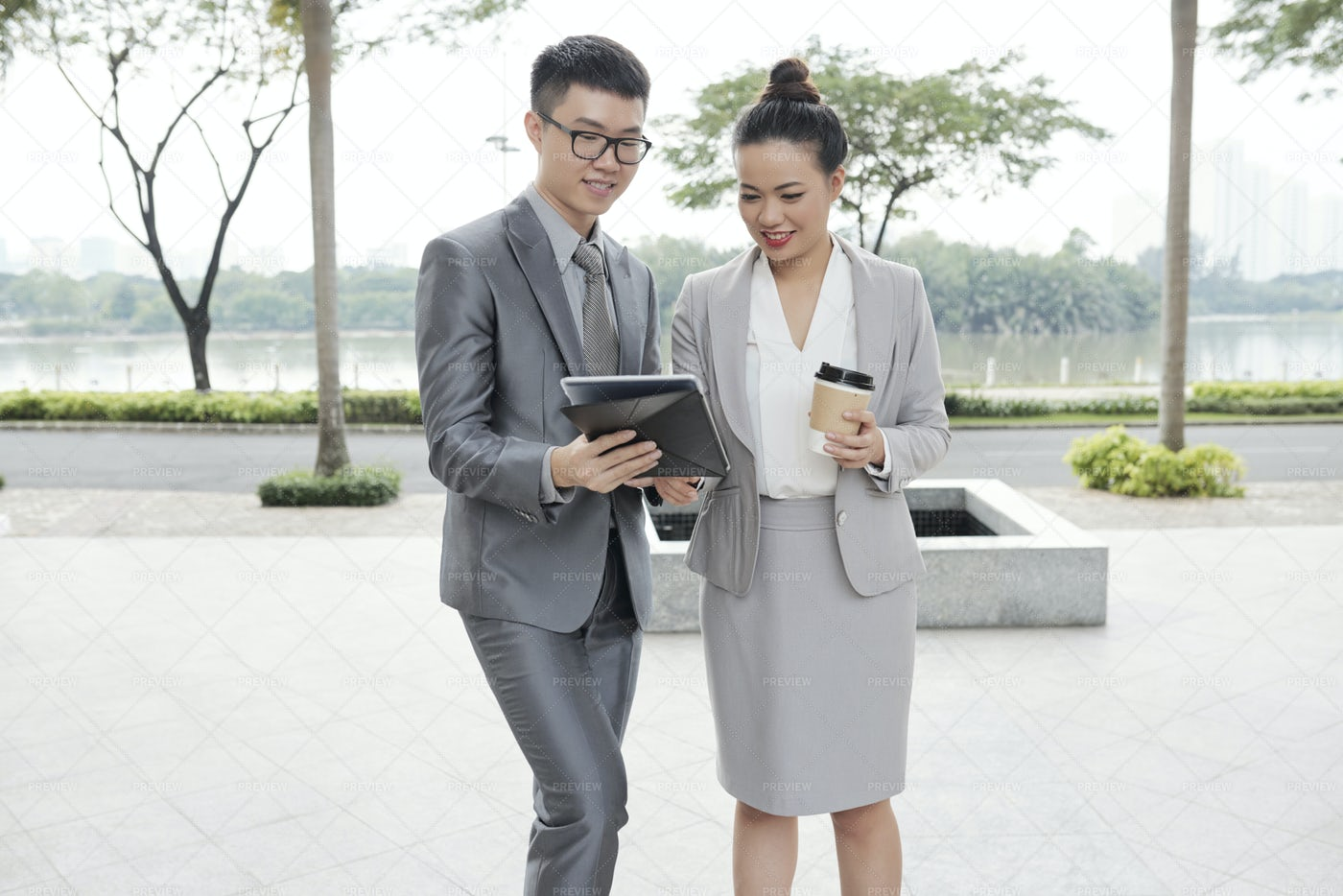 Businessman Sharing Idea With Colleague: Stock Photos