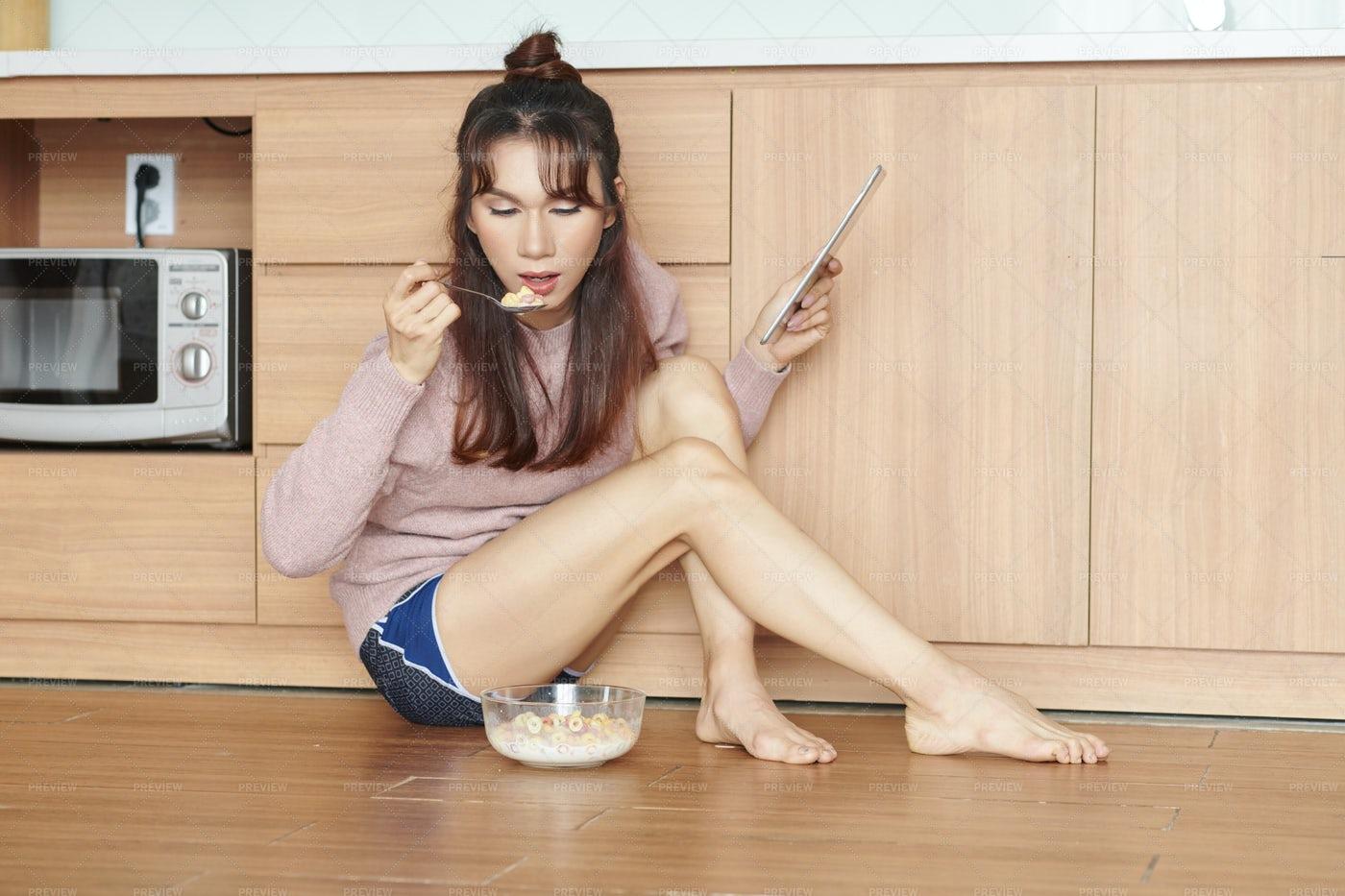 Woman Eating Cornflakes: Stock Photos