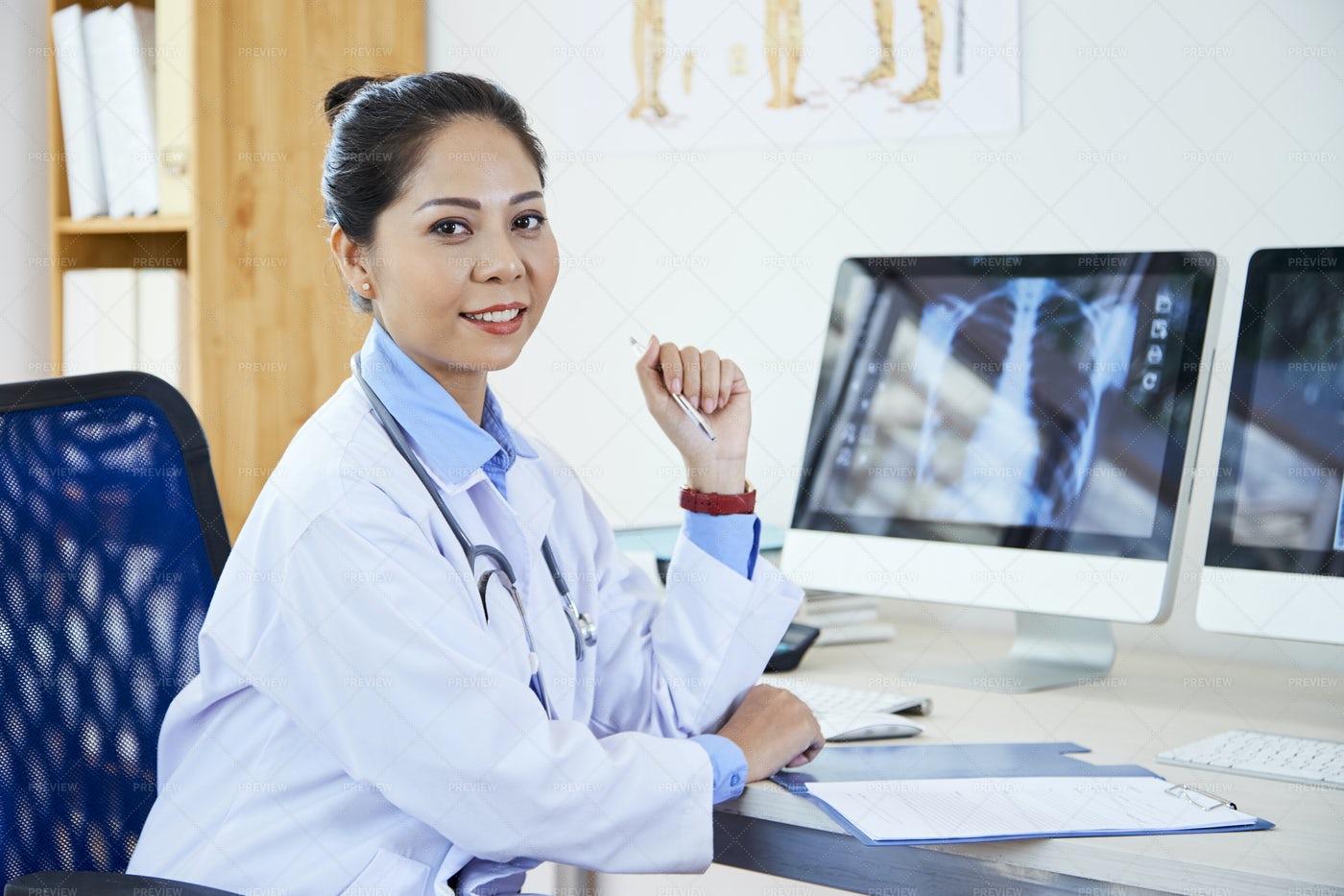 Asian Medical Professional At Work: Stock Photos