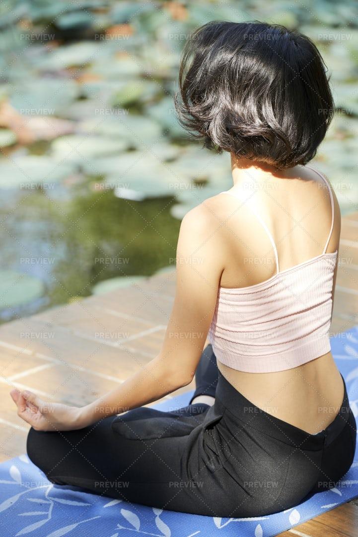 Woman Meditating Outdoors: Stock Photos