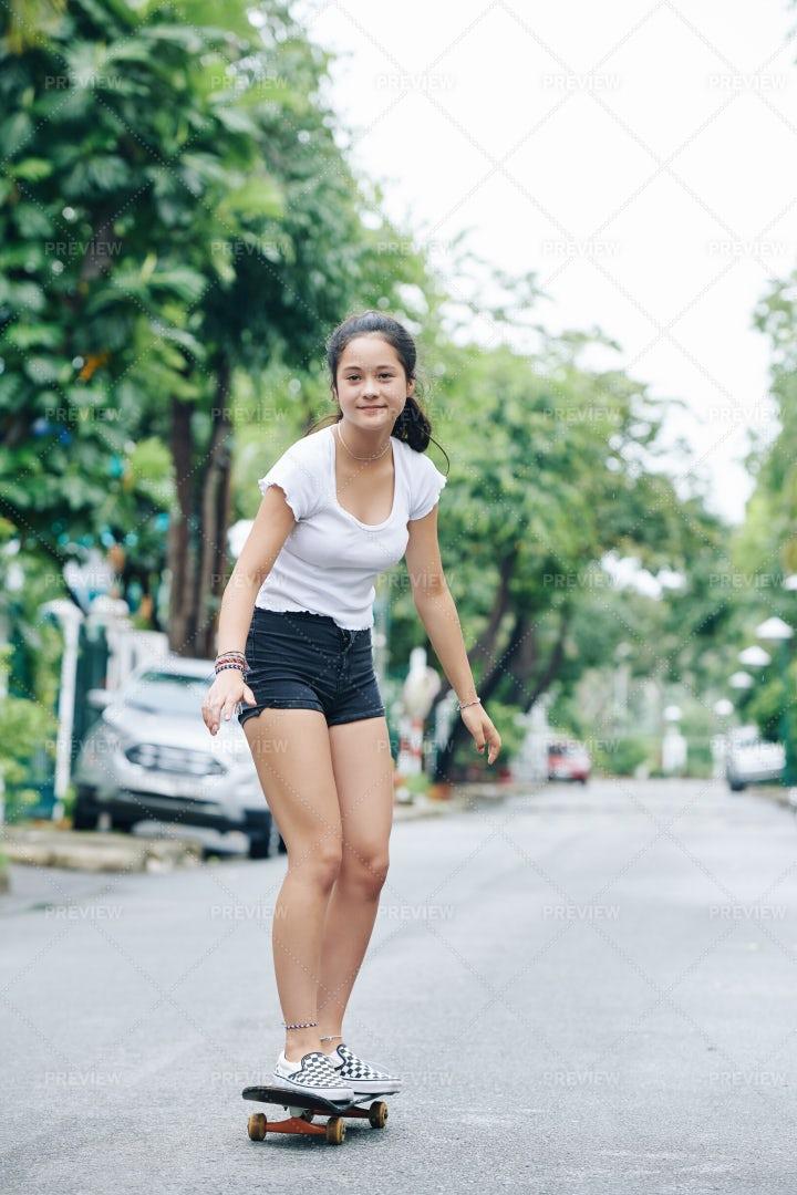 Girl Enjoying Riding On Skateboard: Stock Photos