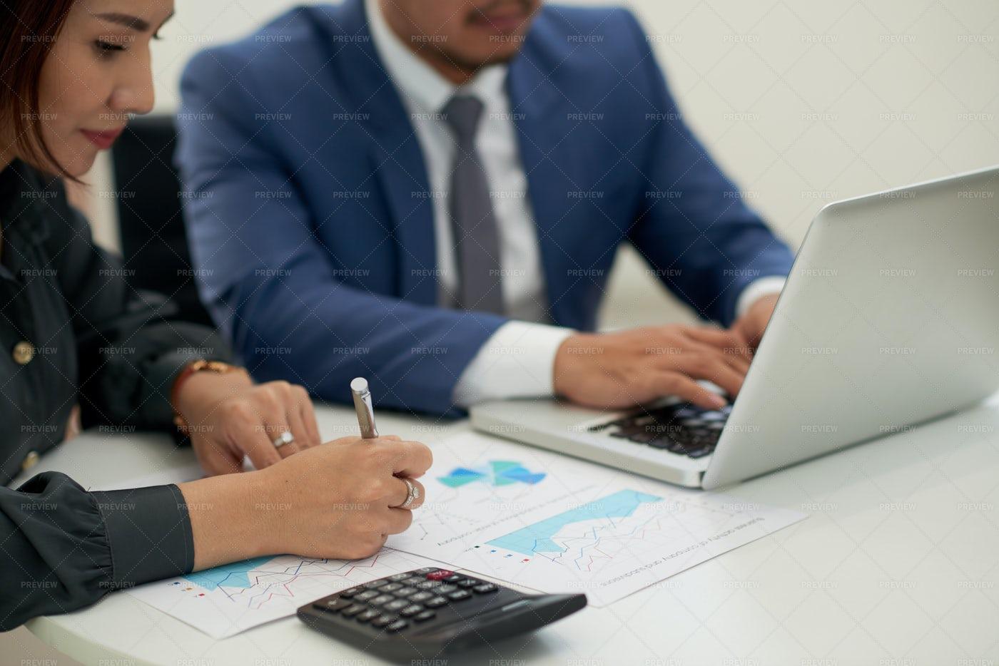 Business Couple Analyzing Marketing: Stock Photos